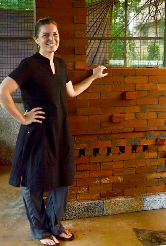Meaghan Gates standing by the newly built kiln, Mananthavady, India, 2015. Photo by Jaya Kumar K.