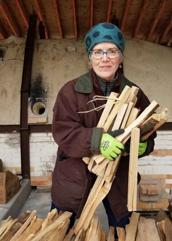 Maureen Mills gathers wood for the New Hampshire Institute of Art (NHIA) Fushigigama (wonder kiln) in Sharon, New Hampshire, 2018.
