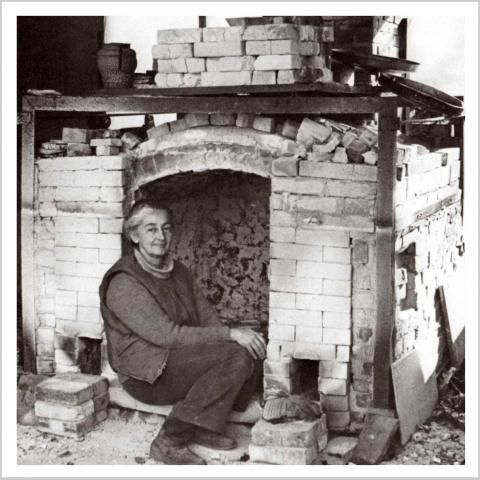Karen Karnes in front of her salt kiln, 1976.