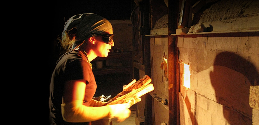 Heidi Kreitchet preparing to stoke the kiln at Pottery West, Las Vegas, Nevada. Photo by Kelly McLendon, 2010.
