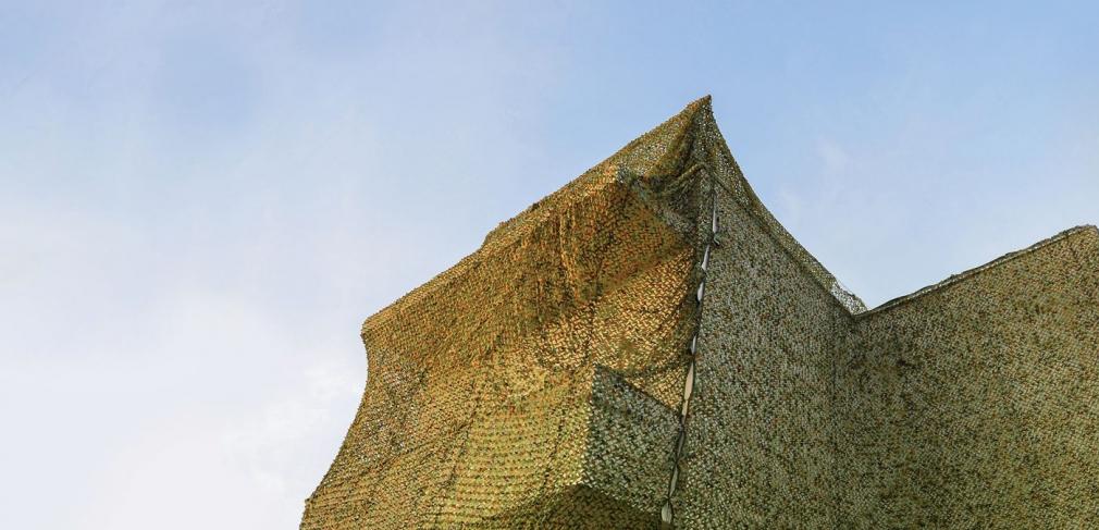 Ayelet Zohar, Villa in the Jungle, 2016. Camouflage nets over Benyamini Center. Photograph by Yael Gurand Zamir Nega.