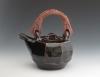 Gunda Stewart, tenmouku teapot with cane handle.