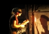 Heidi Kreitchet preparing to stoke the kiln at Pottery West, Las Vegas, Nevada. Photo by Kelly McLendon, 2010.