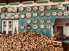 Woodpile and plates outside a potter's home in Olari, Romania. Plates displayed on the outside of a home signify a pottery. All photos by Paula Marian, 2017.