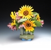 Frank Saliani, Vase with Sunflowers, 2014. Colored, cast and assembled porcelain, cone 6 oxidation. 5 x 5 x 3 in. Photo by artist.