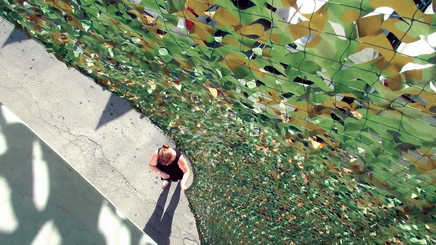 Ayelet Zohar, Villa in the Jungle, 2016. Camouflage nets over Benyamini Center, supported by the Arts Department, Tel Aviv-Jaffa Municipality and the Yehoshua Rabinovich Tel Aviv Foundation for the Arts. Photograph by Yael Gur and Zamir Nega.