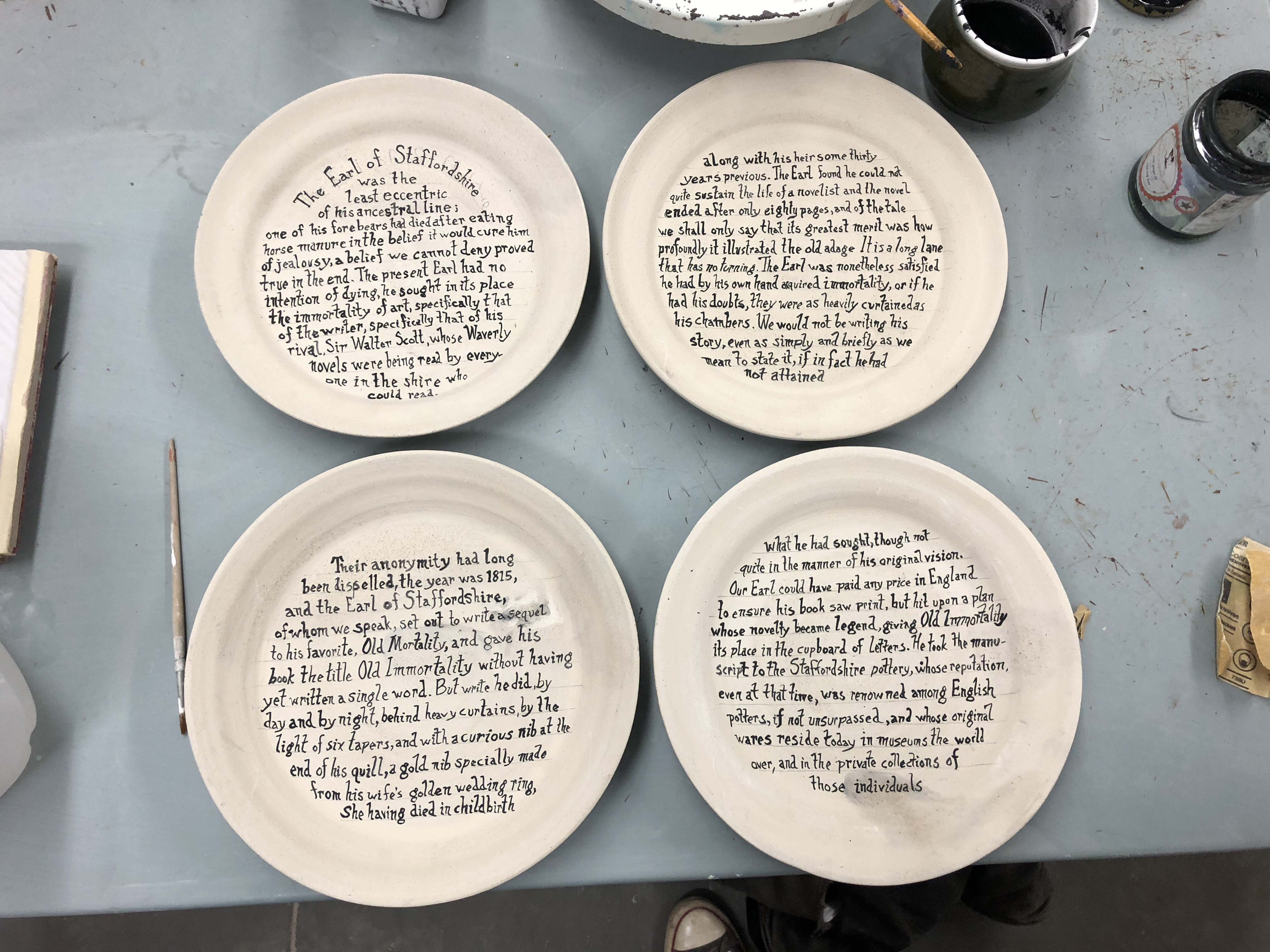 A dinner set for poet Mary Ruefle's April 2020 reading at UMass Amherst has as a centerpiece a plate set inspired by her short prose piece Old Immortality.